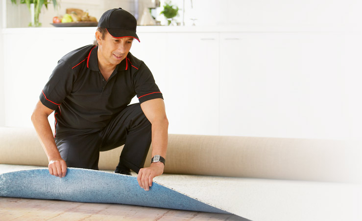 Professionally Installed Carpet in Queen Creek Arizona. Laying_Carpet_Installation